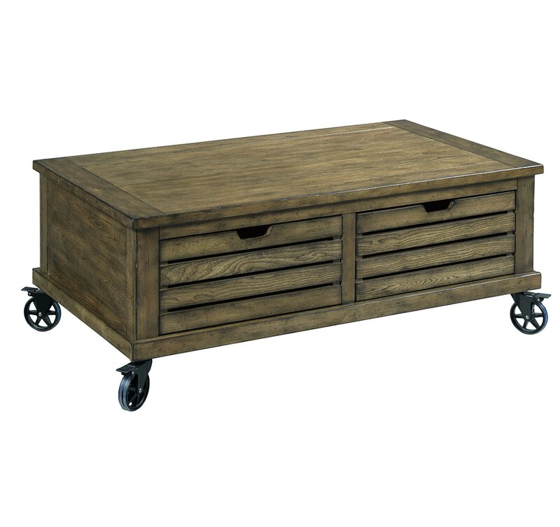 This rustic wood Fontenay Coffee Table has storage and wheels for a casual look in a farmhouse or coastal style interior.