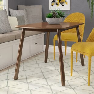 Coupon Bucci Dining Table By Ivy Bronx