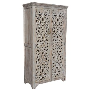 World Menagerie Alaska Hand Carved 2 Door Accent Cabinet