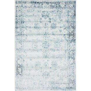 Charming Brandt Light Blue/Ivory Area Rug