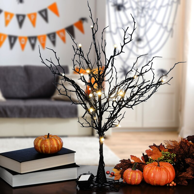 small leafless tree with lights halloween decor