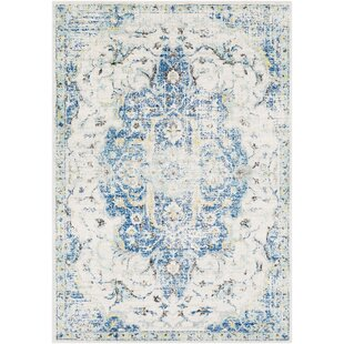 Almonte Distressed Blue/Yellow Area Rug by Bungalow Rose
