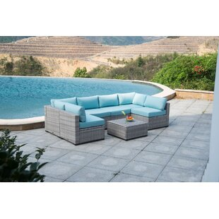 Moore Outdoor 7 Piece Rattan Sectional Seating Group with Cushions