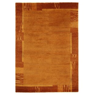 Worrell Handwoven Wool Orange Rug by Charlton Home
