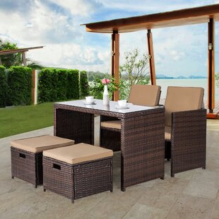 Ebern Designs Nora 5 Piece Rattan Dining Set with Cushions