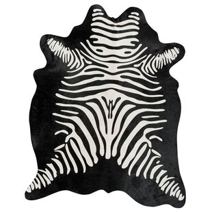 Buying Stenciled Brazilian Cowhide Zebra Reverse Black/White Area Rug By Pergamino