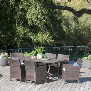 Rick Outdoor Wicker Rectangular 7 Piece Dining Set with Cushions
