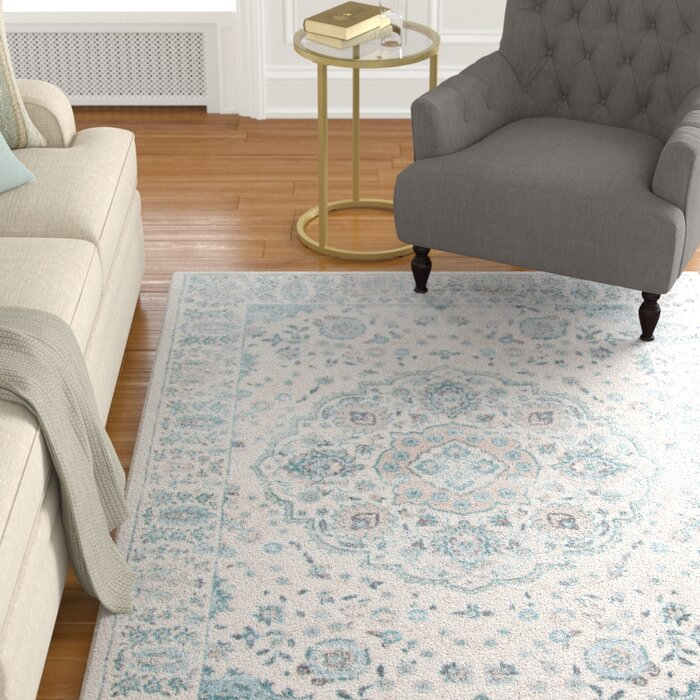 Batholo Blue Ivory Area Rug