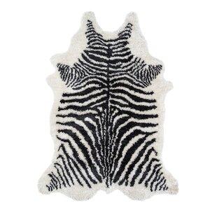 Order Khalhari Hand-Tufted Faux Fur Black Area Rug By Novogratz