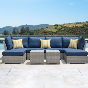 Grijalva 8 Piece Rattan Sectional Seating Group with Cushions