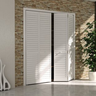 Bi fold doors youll love wayfair plantation louver panel wood bi fold door planetlyrics Gallery