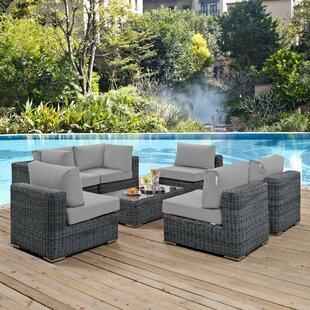 Brayden Studio Alaia 7 Piece Rattan Sunbrella Sectional Seating Group with Cushions