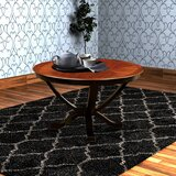 Brucknell Dining Table by World Menagerie