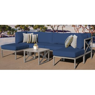 Carlisle Outdoor 7 Piece Sectional Seating Group with Cushions by TK Classics
