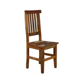 Goulart Solid Wood Dining Chair by Blooms..