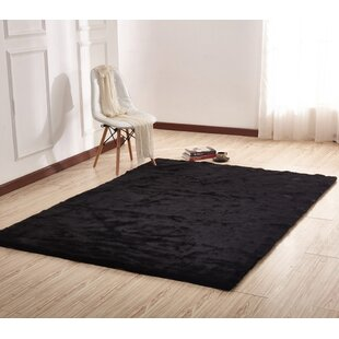 Demaris Faux Fur Black Area Rug