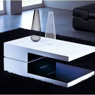 Steve Swivel Coffee Table by Orren Ellis