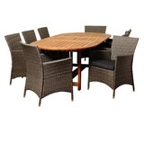 Canaday International Home 9 Piece Dining Set with Cushions