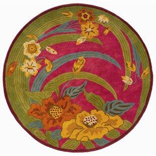 Reviews Leanne Pink Tropical Flowers & Leaves Rug ByZoomie Kids