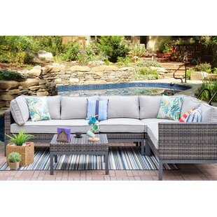 Gonzales 5 Piece Rattan Sectional Seating Group with Cushions by Rosecliff Heights