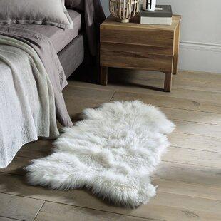 Thurston Faux Sheepskin White Area Rug