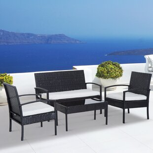 Belinda Outdoor 4 Piece Rattan Sofa Seating Group with Cushions