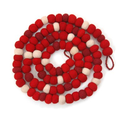 The bright colors and hand-crafted details of this tree garland add a sense of playfulness to your holiday tree, mantle, or doorway. Finished with a glass-beaded loop. 100% Sustainable wool felt. Arcadia Home