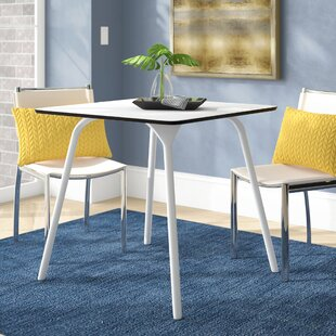 Goggins Plastic/Resin Dining Table by Ebe..