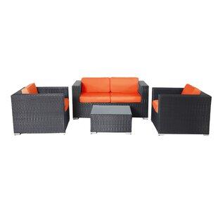 Hibner 4 Piece Rattan Sofa Set with Cushions
