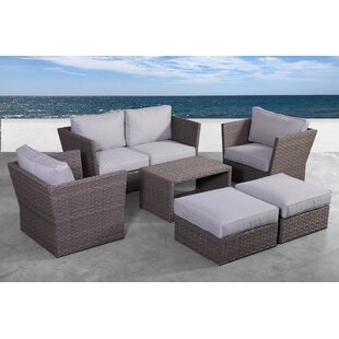 Cody 7 Piece Rattan Sectional Seating Group with Cushions