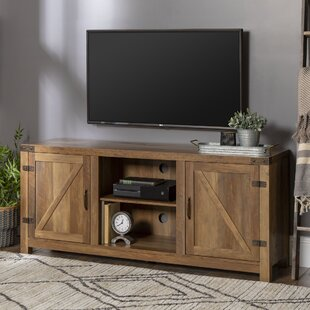 Adalberto TV Stand for TVs up to 65 with optional Fireplace