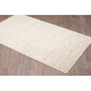 Lauria Solid Texture Hand Woven Wool Ivory Area Rug