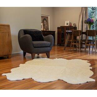 Reviews Curly Zealamb White Rug ByBowron Sheepskin Rugs