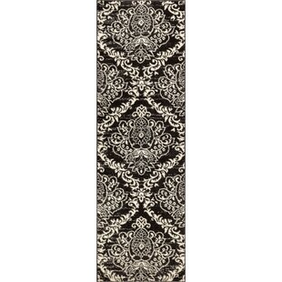Reviews Newquay Magnolia Black/White Area Rug By House of Hampton