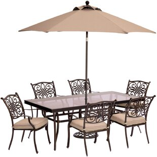 Carleton 7 Piece Golden Bronze Dining Set with Cushions by Fleur De Lis Living