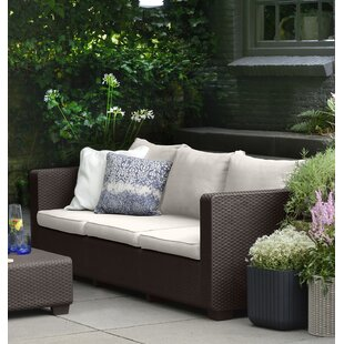 Halloran Patio Sofa with Sunbrella Cushions by Ivy Bronx