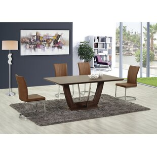 Sauter Solid Wood Dining Table by Orren Ellis