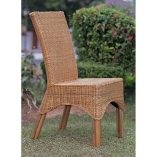 Kakopetria Rattan Dining Chair with Rattan Pole Legs by Bay Isle Home