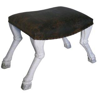 Noir Claw Leg Saddle Stool