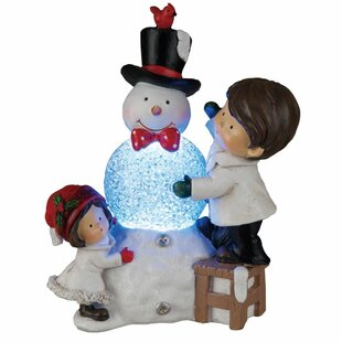 Light up outdoor snowman wayfair light up children with snowman figurine mozeypictures Image collections