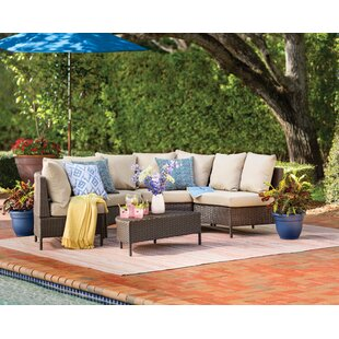 Dowd 5 Piece Rattan Sectional Set with Cushions