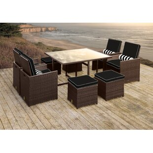 Stella II Patio Rattan 9 Piece Dining Set with Cushions and Cylinder Toss Pillows by Solis Patio