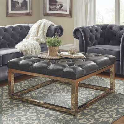 House of Hampton Gilham Tufted Ottoman Upholstery: Dark Brown Faux Leather, Color: Champagne Gold
