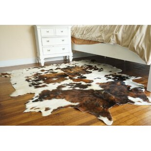 Compare & Buy Parma Cowhide Brown/White Area Rug By Loon Peak