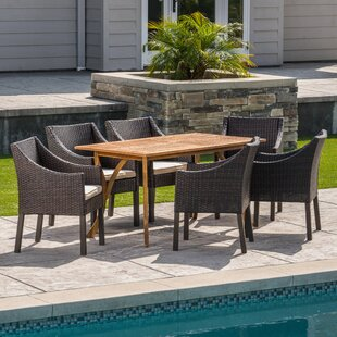 Wrought Studio Hensel Outdoor Acacia Wood/Wicker 7 Piece Dining Set with Cushions