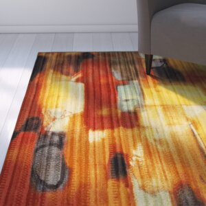 Buckler Red Area Rug