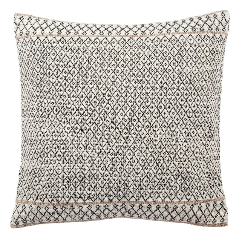 When you want a tribal boho global artisan pillow - this Elita Tribal Pattern Throw Pillow may fit the bill. Crafted from silk, the removable cover boasts a geometric pattern, offering a touch of visual texture, while its feather fill gives it its square silhouette. Plus, measuring 18'' H x 18'' W, it fits easily on any couch in your sitting room.
