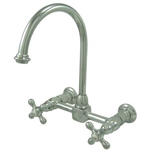 Kingston Brass Restoration Wall Mounted Double Handle Kitchen Faucet