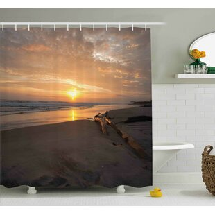 Cathleen Driftwood Golden Sun Rises Over a Distant Horizon Sandy Beach and Driftwood Single Shower Curtain