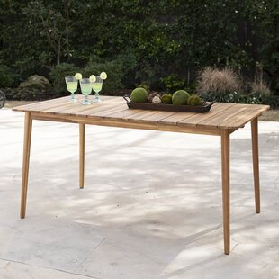 Ila Solid Wood Dining Table by Bay Isle H..
